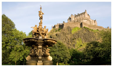 Photograph of the Ross Fountain in Princes Steet Gardens, Edinburgh with Edinburgh Castle forming the background skyline